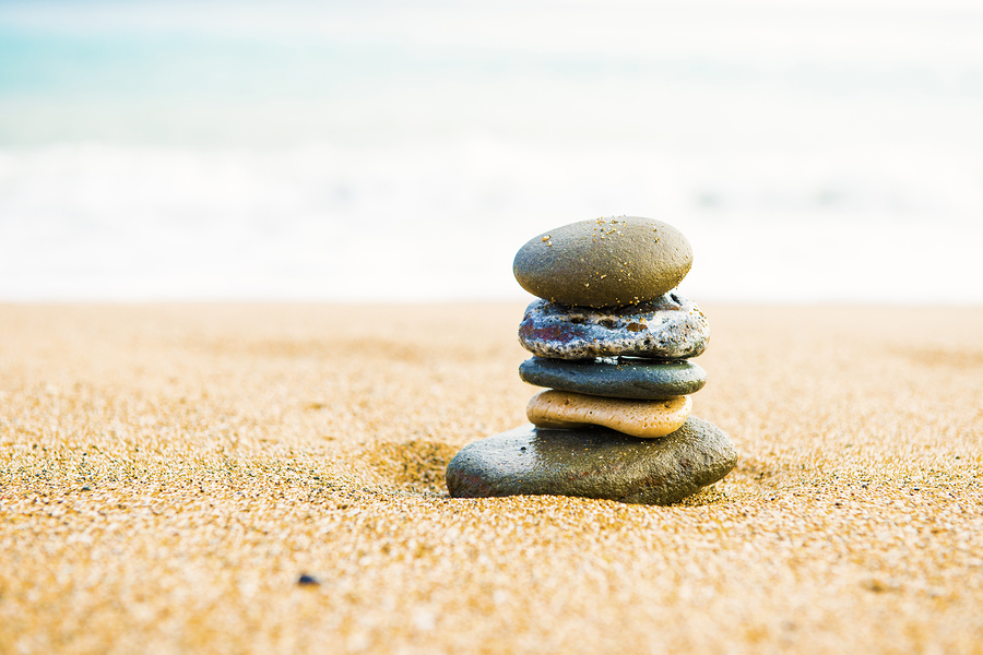 bigstock-Five-stones-balanced-on-top-of-99393227.jpg